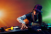 Hiphop DJ woman playing at nightclub party lifestyle