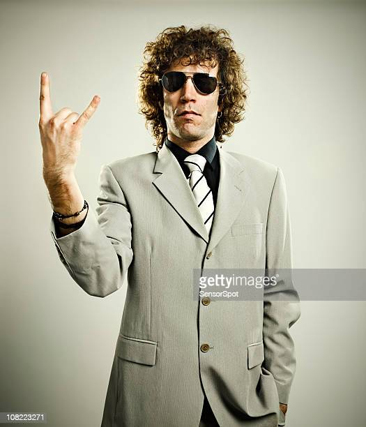 Trendy Man Giving Rock Sign