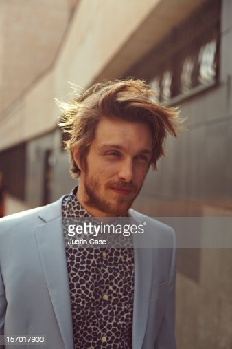 A  trendy man walking city streets : Stock Photo