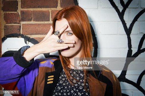 trendy woman posing for camera