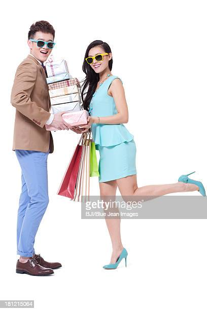 Trendy young couple with cool sunglasses shopping