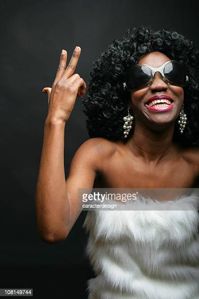 Trendy Young Woman Posing and Smiling on Black Background
