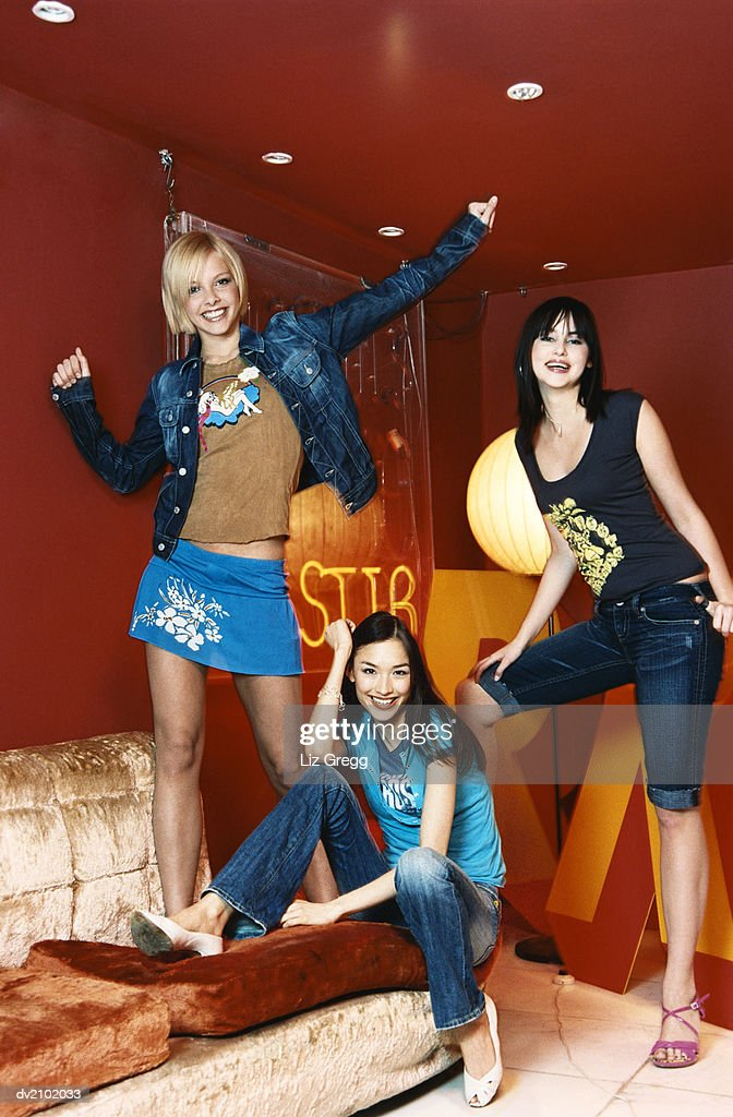 Trendy Young Women in a Studio : Stock Photo