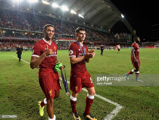 Trent AlexanderArnold and Ben Woodburn of Liverpool at the end of the Premier League Asia Trophy match between Liverpool FC and Leicester City FC at...