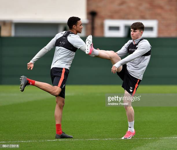 Trent AlexanderArnold and Ben Woodburn of Liverpool during a training session at Melwood Training Ground on April 3 2017 in Liverpool England