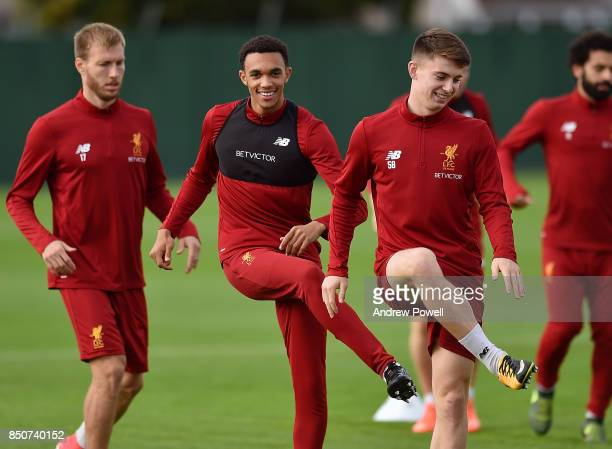 Trent AlexanderArnold and Ben Woodburn of Liverpool during a training session at Melwood Training Ground on September 21 2017 in Liverpool United...