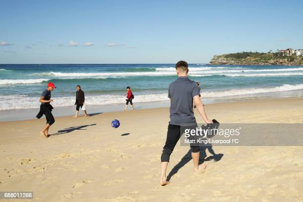 Trent AlexanderArnold and Ben Woodburn of Liverpool kick a football during a Liverpool FC Fan Day at Bondi Beach on May 25 2017 in Sydney Australia