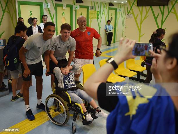 Trent AlexanderArnold and Ben Woodburn of Liverpool visit The Duchess of Kent Children's Hospital Hong Kong during the PreSeason tour on July 17 2017...