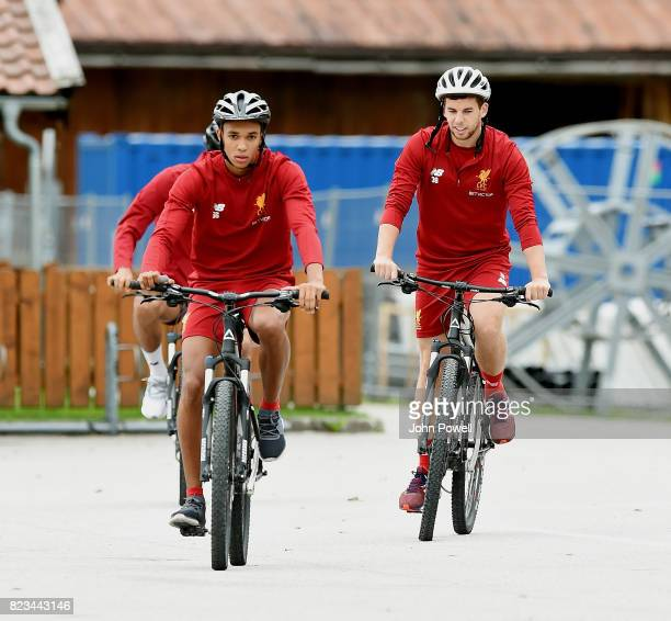 Trent AlexanderArnold and Jon Flanagan of Liverpool on a bike riding to a training session at RottachEgern on July 27 2017 in Munich Germany