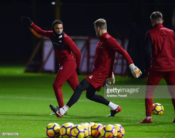 Trent AlexanderArnold and Simon Mignolet of Liverpool during a training session at Melwood Training Ground on November 23 2017 in Liverpool England