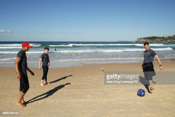 Trent AlexanderArnold Ben Woodburn and Simon Mignolet of Liverpool kick a football during a Liverpool FC Fan Day at Bondi Beach on May 25 2017 in...