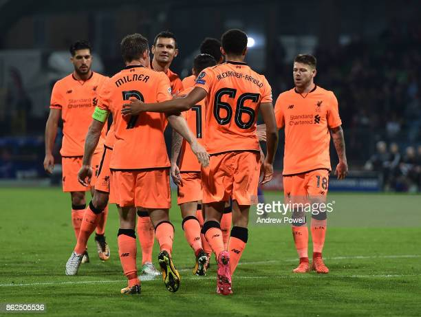 Trent AlexanderArnold of Liverpool celebrates after scoring the seventh and final goal during the UEFA Champions League group E match between NK...