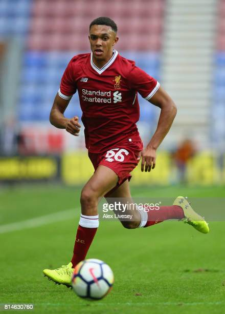 Trent AlexanderArnold of Liverpool runs with the ball during the preseason friendly match between Wigan Athletic and Liverpool at DW Stadium on July...