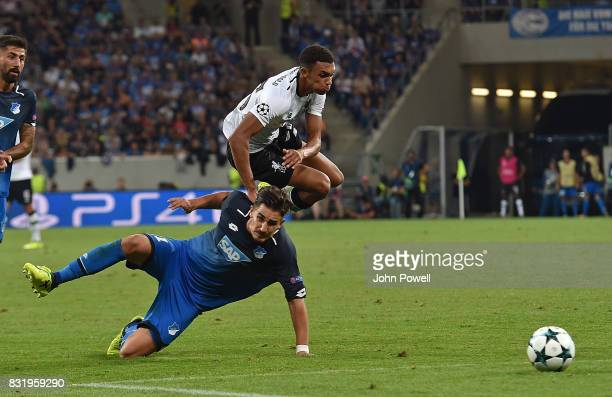 Trent AlexanderArnold of Liverpool with Steven Zuber of TSG 1899 during the UEFA Champions League Qualifying PlayOffs Round First Leg match between...