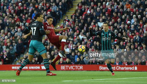 Trent AlexanderArnold of Liverpool withVirgil Van Dijk of Southampton during the Premier League match between Liverpool and Southampton at Anfield on...