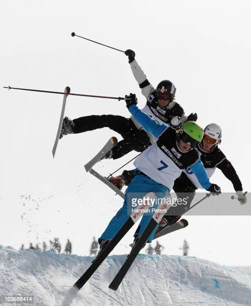 Trent Alkemade of Australia Yannick Enting of the Netherlands and Ethan Fortney of USA compete in the Men's Ski Cross event during the Junior World...