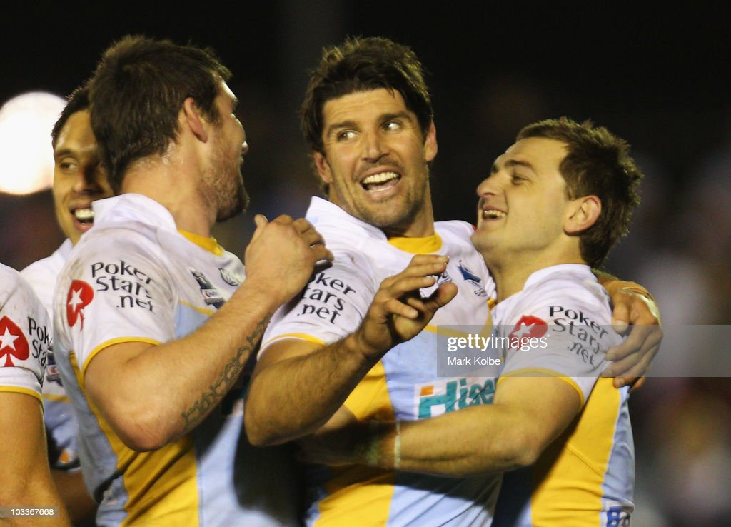 Trent Barrett and Nathan Gardner of the Sharks celebrate winning the round 23 NRL match between the Cronulla Sharks and the Sydney Roosters at Toyota Stadium on August 13, 2010 in Sydney, Australia.
