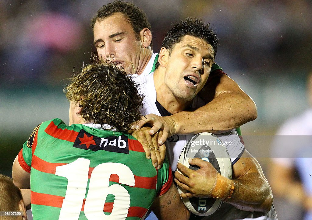 Trent Barrett of the Sharks is tackled during the round three NRL match between the Cronulla Sharks and the South Sydney Rabbitohs at Toyota Stadium on March 29, 2010 in Sydney, Australia.