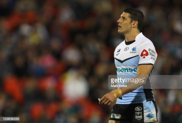 Trent Barrett of the Sharks looks dejected as he watches the big screen during the round 26 NRL match between the Penrith Panthers and the Cronulla...
