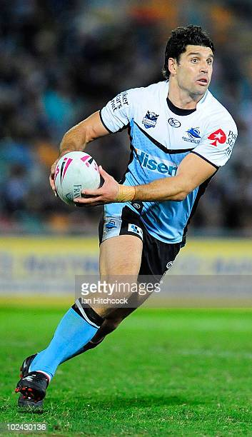 Trent Barrett of the Sharks runs the ball during the round 16 NRL match between the North Queensland Cowboys and the Cronulla Sharks at Dairy Farmers...