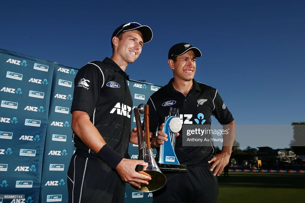 Trent Boult and Ross Taylor of New Zealand celebrate with the Chappell-Hadlee Trophy and ANZ Series Trophy after winning game three of the One Day International series between New Zealand and Australia at Seddon Park on February 5, 2017 in Hamilton, New Zealand.