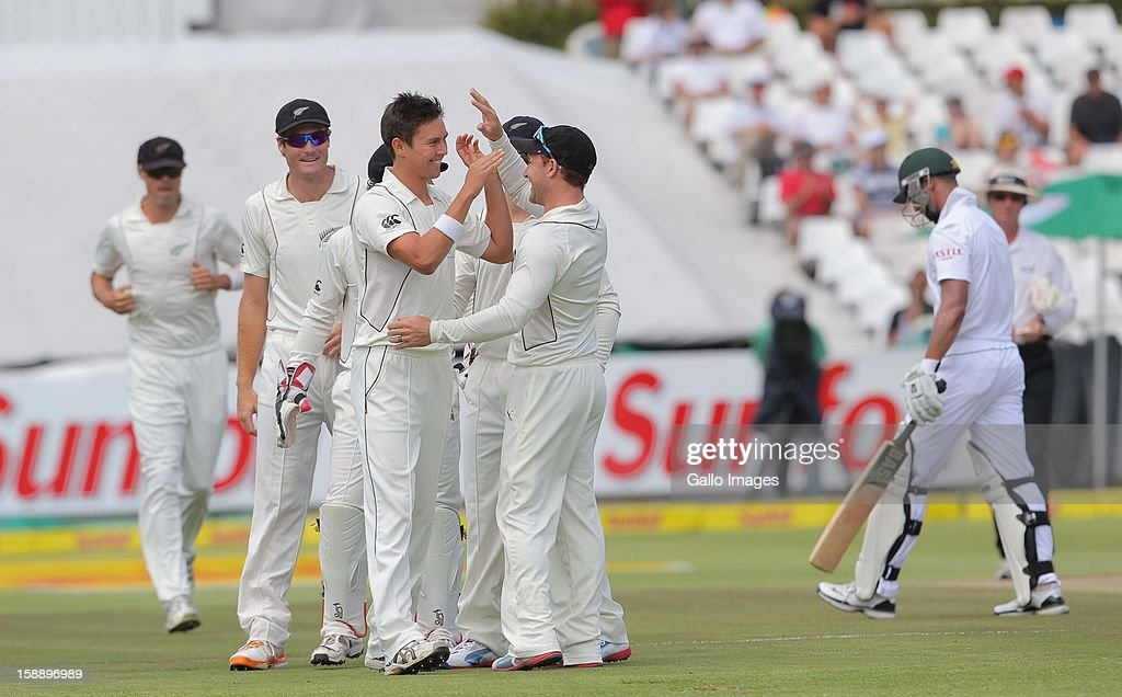 Trent Boult celebrates the wicket of <a gi-track='captionPersonalityLinkClicked' href=/galleries/search?phrase=Alviro+Petersen&family=editorial&specificpeople=4969996 ng-click='$event.stopPropagation()'>Alviro Petersen</a> of the Proteas during day 2 of the 1st Test between South Africa and New Zealand at Sahara Park Newlands on January 03, 2013 in Cape Town, South Africa.