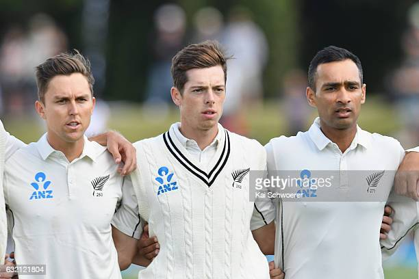 Trent Boult Mitchell Santner and Jeet Raval of New Zealand line up for their national anthem during day one of the Second Test match between New...