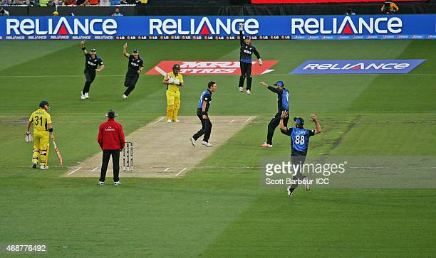 Trent Boult of New Zealand celebrates after dismissing Aaron Finch of Australia during the 2015 ICC Cricket World Cup final match between Australia...