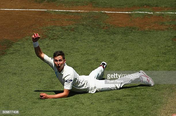 Trent Boult of New Zealand celebrates after taking a catch off his own bowling to dismiss Mitch Marsh of Australia during day two of the Test match...