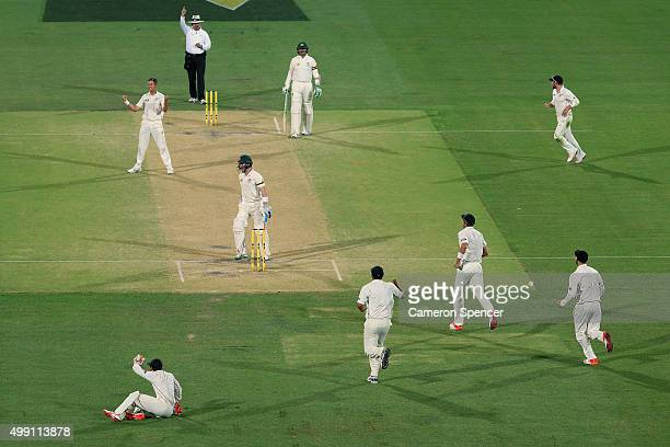 Trent Boult of New Zealand celebrates as Peter Nevill of Australia is caught out by BJ Watling of New Zealand during day three of the Third Test...