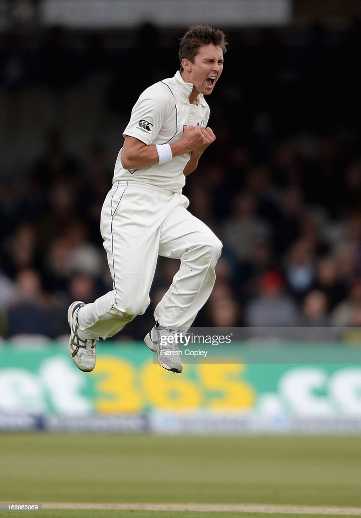 Trent Boult of New Zealand celebrates dismissing England captain Alastair Cook during day one of 1st Investec Test match between England and New Zealand at Lord's Cricket Ground on May 16, 2013 in London, England.