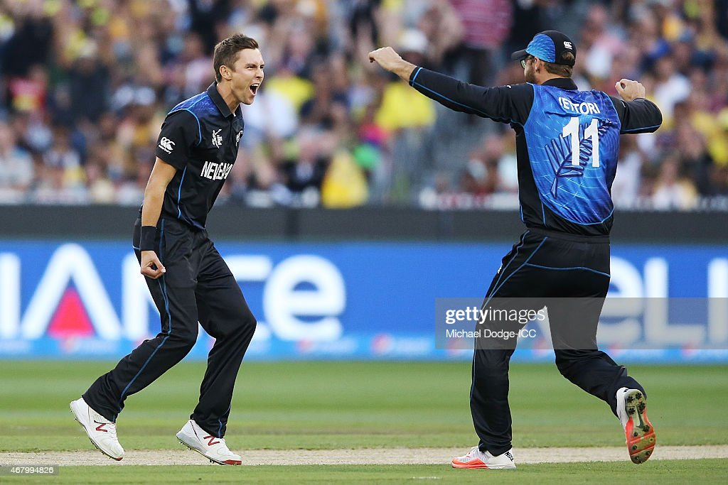 Trent Boult of New Zealand celebrates his dismissal of Aaron Finch of Australia with Daniel Vettori of New Zealand during the 2015 ICC Cricket World...