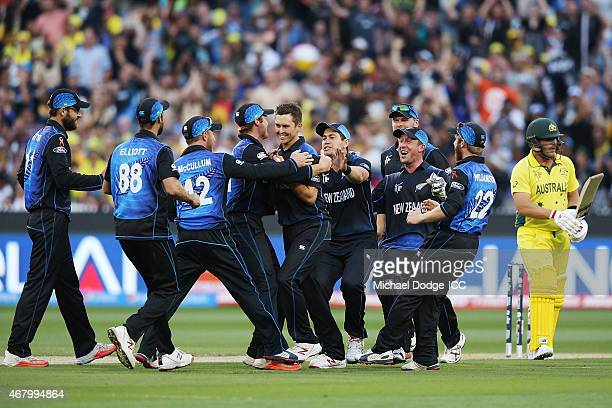 Trent Boult of New Zealand celebrates his dismissal of Aaron Finch of Australia with teamates during the 2015 ICC Cricket World Cup final match...