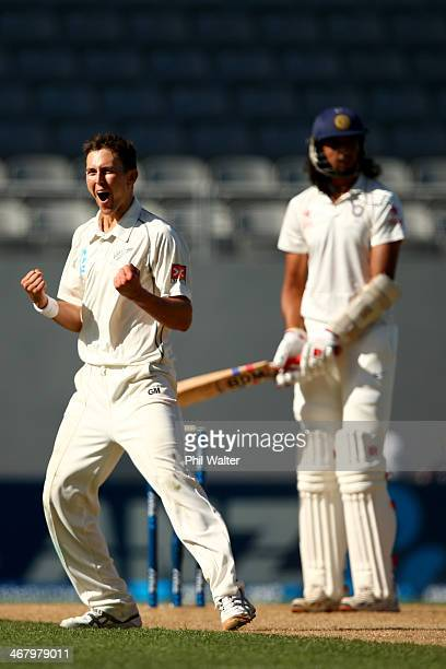 Trent Boult of New Zealand celebrates his wicket of Ishant Sharma of India during day four of the First Test match between New Zealand and India at...