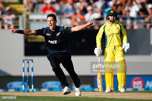 Trent Boult of New Zealand celebrates his wicket of Mitchell Marsh of Australia during the One Day International match between New Zealand and...