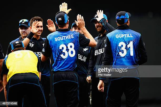 Trent Boult of New Zealand celebrates his wicket of Quinton de Kock of South Africa during the 2015 Cricket World Cup Semi Final match between New...