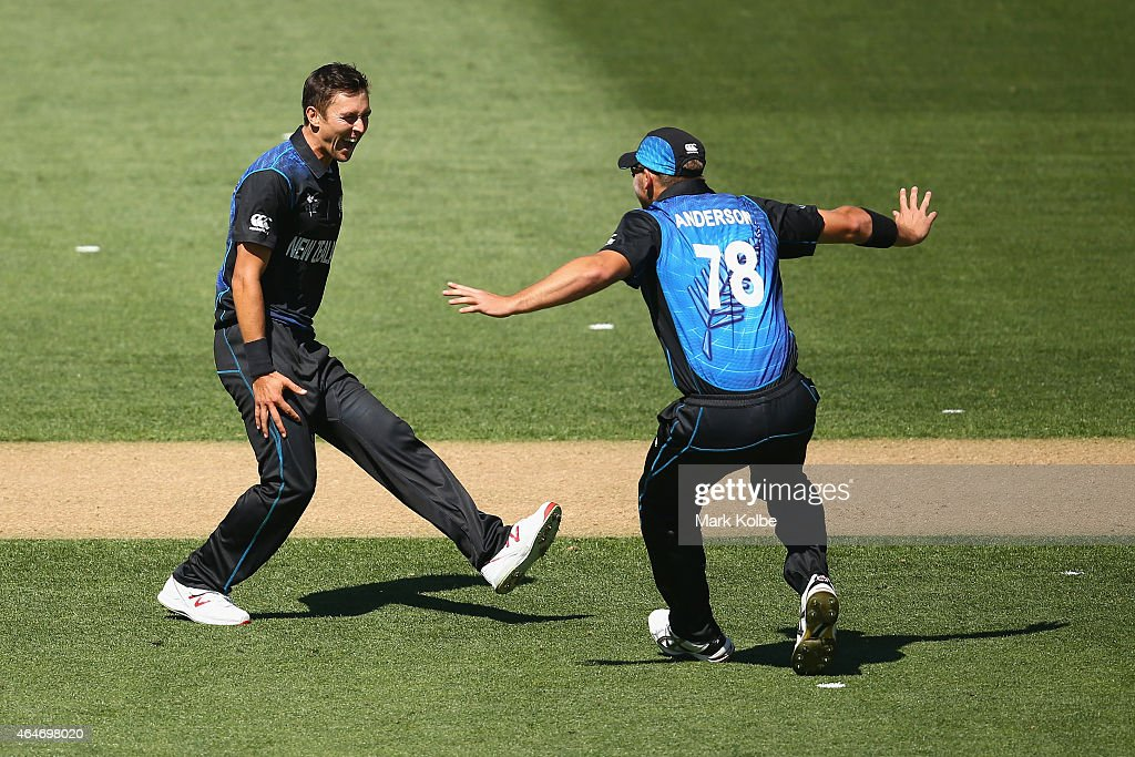 <a gi-track='captionPersonalityLinkClicked' href=/galleries/search?phrase=Trent+Boult&family=editorial&specificpeople=4880813 ng-click='$event.stopPropagation()'>Trent Boult</a> of New Zealand celebrates taking the wicket of Mitch Marsh of Australia with <a gi-track='captionPersonalityLinkClicked' href=/galleries/search?phrase=Corey+Anderson+-+Cricketspeler&family=editorial&specificpeople=12457249 ng-click='$event.stopPropagation()'>Corey Anderson</a> of New Zealand during the 2015 ICC Cricket World Cup match between Australia and New Zealand at Eden Park on February 28, 2015 in Auckland, New Zealand.