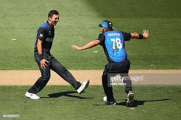 Trent Boult of New Zealand celebrates taking the wicket of Mitch Marsh of Australia with Corey Anderson of New Zealand during the 2015 ICC Cricket...