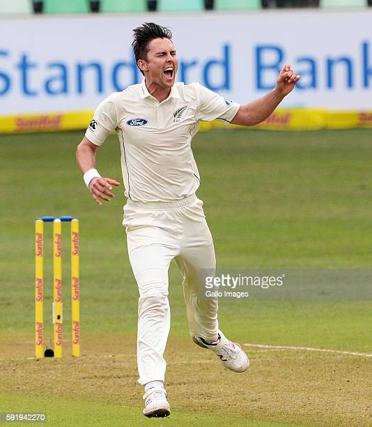 Trent Boult of New Zealand celebrates the wicket of Stephen Cook of the Proteas during Day 1 of the 1st Sunfoil International Test match between...