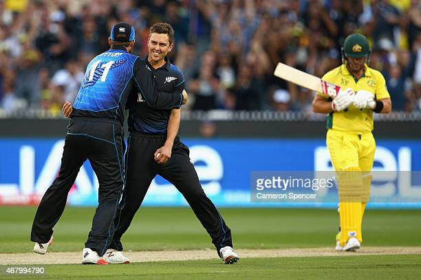 Trent Boult of New Zealand celebrates with team mate Daniel Vettori after dismissing Aaron Finch of Australia caught and bowled during the 2015 ICC...