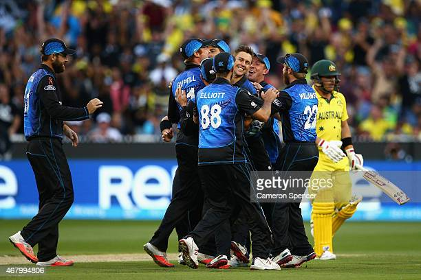 Trent Boult of New Zealand celebrates with team mates after dismissing Aaron Finch of Australia caught and bowled during the 2015 ICC Cricket World...