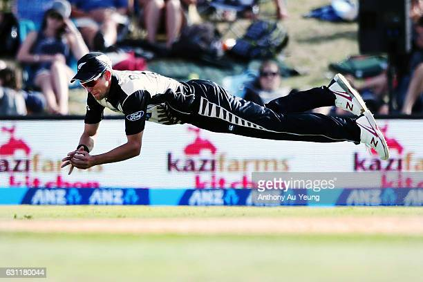 Trent Boult of New Zealand dives for the ball during the third Twenty20 International match between New Zealand and Bangladesh at Bay Oval on January...