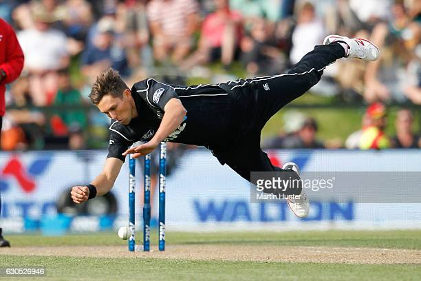Trent Boult of New Zealand fields the ball after bowing during the first One Day International match between New Zealand and Bangladesh at Hagley...