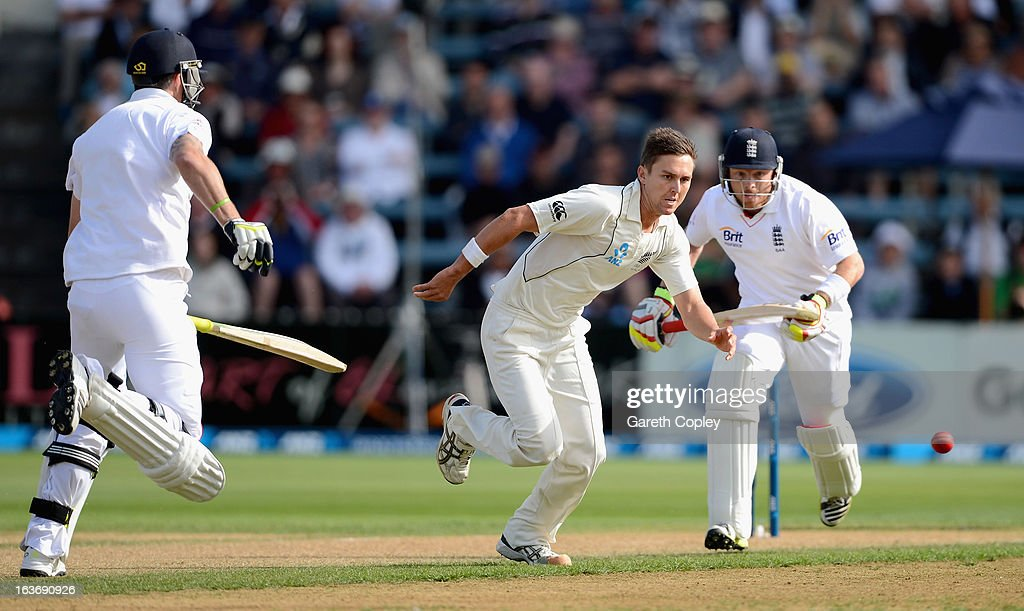 Trent Boult of New Zealand fields the ball as <a gi-track='captionPersonalityLinkClicked' href=/galleries/search?phrase=Kevin+Pietersen+-+Cricket+Player&family=editorial&specificpeople=202001 ng-click='$event.stopPropagation()'>Kevin Pietersen</a> and <a gi-track='captionPersonalityLinkClicked' href=/galleries/search?phrase=Ian+Bell&family=editorial&specificpeople=206128 ng-click='$event.stopPropagation()'>Ian Bell</a> of England score runs during day two of the second Test match between New Zealand and England at Basin Reserve on March 15, 2013 in Wellington, New Zealand.