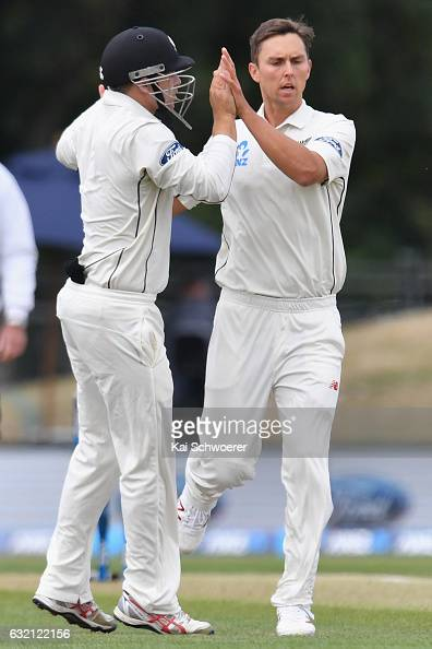 Trent Boult of New Zealand is congratulated by Tom Latham of New Zealand after dismissing Mahmudullah of Bangladesh during day one of the Second Test...