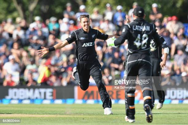 Trent Boult of New Zealand is congratulated by Tom Latham of New Zealand after dismissing AB de Villiers of South Africa during game two of the One...