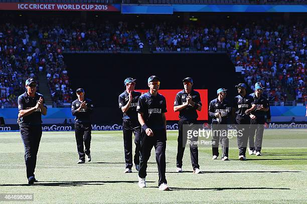 Trent Boult of New Zealand leads his team from the ground after taking 5/27 during the 2015 ICC Cricket World Cup match between Australia and New...