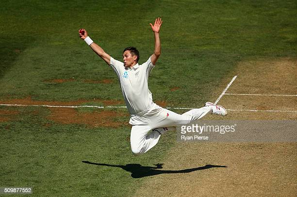 Trent Boult of New Zealand takes a catch off his own bowling to dismiss Mitch Marsh of Australia during day two of the Test match between New Zealand...