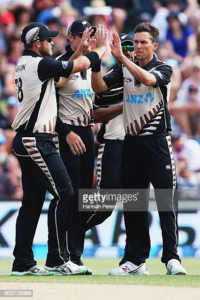 Trent Boult of the Black Caps celebrates the wicket of Tillakaratne Dilshan of Sri Lanka with Corey Anderson of the Black Caps during the Twenty20...
