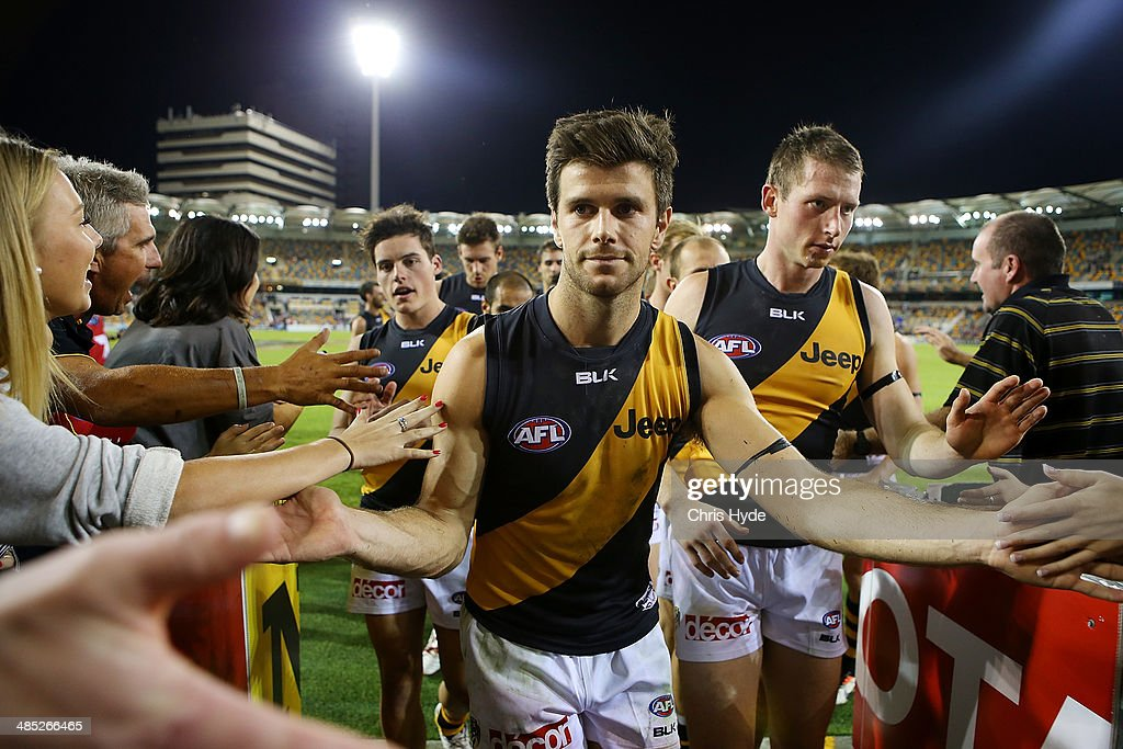 Trent Cochin of the Tigers celebrates winning the round five AFL match between the Brisbane Lions and the Richmond Tigers at The Gabba on April 17, 2014 in Brisbane, Australia.